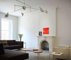 Charles Sofa designed by Antonio Citterio for B Italia. Overhead light fixture by David Weeks. T. H. Robsjohn-Gibbings Amoeba coffee table.