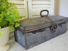 vintage metal tool box [I guess it is a tool box, unique top!]