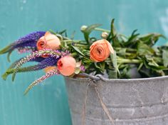 vintage bucket with colorful flowers