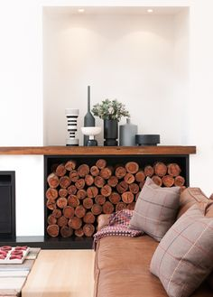 Liking this log storage detail and the display of vases - by Australian photographer Tom Blachford.