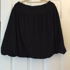 Talbots black, jersey skirt. Adorable and comfortable black jersey skirt from Talbots. The hemline folds under in a sort of bubble-like manner (see picture). Great easy piece. Talbots Skirts A-Line or Full