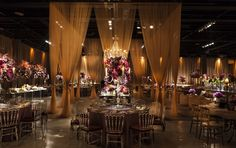 Purple and gold wedding decoration with purple arragements and gold curtains, acrylic chairs, chandeliers, candles and candlesticks