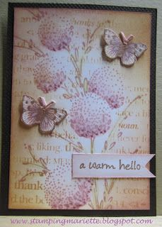 """By Mariëtte van Leeuwen. Uses flower stamp from """"Delicate Florals"""" by Penny Black and Distress inks victorian velvet, crouched olive, & tea dye. Other materials listed on website."""