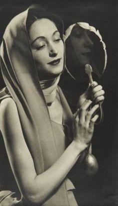 Man Ray ~ Nusch Eluard with a Mirror, 1935
