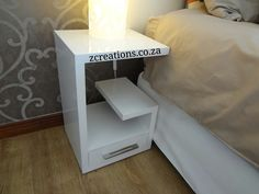 G-shape pedestal/bedside table