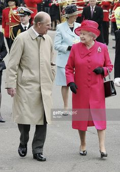 Queen Elizabeth II and Prince Philip, Duke of Edinburgh smile at each other on April 21, 2006 in Windsor, England. HRH Queen Elizabeth II is taking part in her traditional walk in the town to celebrate her 80th Birthday. In the evening the Prince of Wales will host a private party for The Queen and other members of the Royal family at Kew Palace.