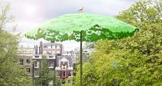 Design by Chris Kabel, By Droog. The Shadylace Parasol allows just a little sun to shine through, creating a dappled shade. The Shadylace Parasol even comes with a small bird perched on the top. Available in Green or White.
