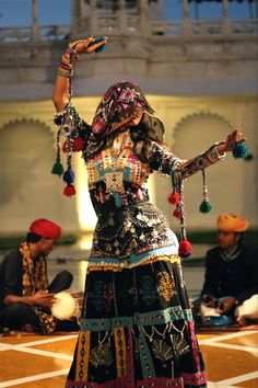 Lake Palace Hotel in Udaipur, India. Woman performing traditional dance common to Rajasthani region of India. /pstampe/tribal-dance/ BACK Bollywood Stars, Female Dancers, Folk Dance, Tribal Fusion, Folk Costume, Costumes, Belly Dancers, Just Dance, World Cultures