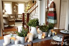"""Finding Home Holiday Housewalk - Dining Room to Hall - LOVE the tablescape and the vintage """"suitcase tree"""" in the background"""