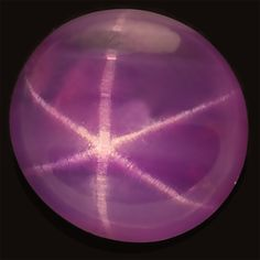 """Star sapphire, also known as """"star"""" in the trade. Cabochon-cut star sapphires characteristically shows a six-rayed star. Although stars can occur in a range of colors many stars are grayish or dark and the supply of fine stones is always limited.    Discover @ www.multicolour.com or #gemstones #sapphire #asterism"""