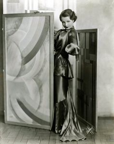 a great way to add some vintage vibes is to fram some iconic images of old hollywood or even old landscape images. here is a great Art Deco - Old Hollywood glamour image