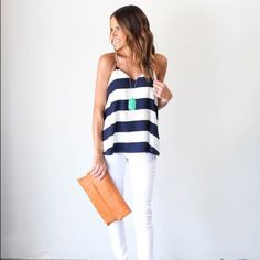 Vici Collection Beckett Tank Simplicity is key and we are certain the Beckett tank will be your new go-to! Simply chic, this navy and white striped tank has Racerback straps and a sweet flirty cut. Vici Collection Tops Tank Tops