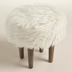Featuring a plush, ivory-toned faux fur top inspired by the flokati wool shag rugs of Greece, our fun and modern hardwood footstool is ideal in front of an accent chair or at the foot of a bed. www.worldmarket.com #WorldMarket #FallHomeRefresh