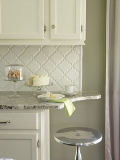 Clear solid crystal knobs.  Arabesque tile.