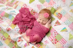 On a quilt made by her grandma!  Caralee Case Photography, newborn infant baby photographer.  #newbornphotography #caraleecasephotography #babies