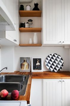 white kitchen, natural wood open shelves...like these only thicker wood