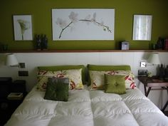 The emphasis in this room is the pea green color that they have for the wall and on the throw pillows.