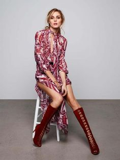 Olivia Palermo wears a '70s inspired dress and lace up knee high boots.