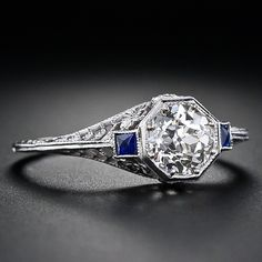 Vintage engagement ring - $4250 .79cts, SI1, K, sapphire (artificial) accents