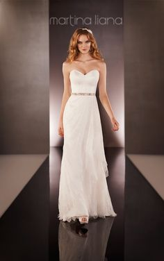 Find your ivory Lace over Parisian Silk Chiffon modified A-line wedding dress with a strapless sweetheart bodice, Lace layering on the skirt, and a Lace sweep train.