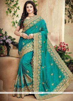 We unfurl our the intricacy and exclusivity of our creations highlighted with this stunning sea green crepe silk traditional designer saree. The ethnic embroidered, patch border and resham work with t. Wedding Saree Collection, Designer Sarees Collection, Designer Silk Sarees, Designer Sarees Online, Art Silk Sarees, Trendy Sarees, Fancy Sarees, Party Wear Sarees, Lehenga Choli