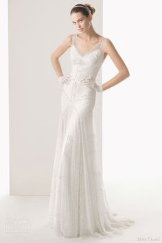 Rosa Clara sleeveless wedding gown featuring tulle overlay with beadwork embroidery and crepe underskirt