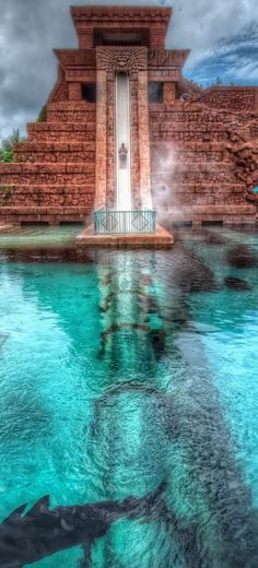 Atlantis in the Bahamas. From the top of the slide catapults riders into a transparent tunnel and through a shark-filled lagoon.