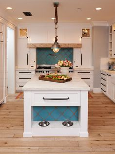 Kitchen island design. Kitchen with built-in pet bowls