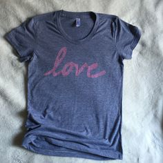 Love stamped on American Apparel tri-blend tees for women.  Made in the USA.  This is a PRE-ORDER and they'll begin shipping out mid January.