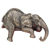 Found it at Wayfair - Ernest the Lounging Elephant Sitting Statue. $33