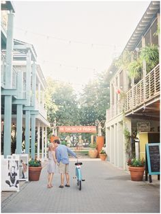 SEASIDE FL ~ Shoppes on Left & Right in the Ruskin Place ART DISTRICT ...(See the Orange Sign up ahead? There you will find a lovely greens space just beyond that sign + Cool Gnarly Trees, benches etc. and All around this greenspace [in kind of a U shape] is what used to be 2 and 3 storied townhomes with the MOST charming porches - sometimes rentals, etc that have now become more shops and galleries, etc.) 30a SoWal