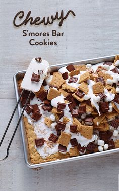 Everything you love about cookies and s'mores are all part of this Chewy S'mores Bar Cookies recipe. These cookies are made with HERSHEY'S Milk Chocolate Bars, miniature marshmallows and graham crackers! It's the perfect treat for a campfire, party or sleepover.
