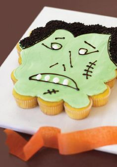 "Monster ""Cake"" -- No specially shaped cake pan is required to make this Halloween dessert showstopper; it's just cupcakes in disguise! Check out the video to see how this recipe is done."