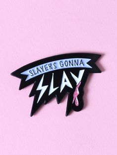 "BAND OF WEIRDOS I'm that thing monsters have nightmares about. Enamel lapel pin with ""SLAYERS GONNA SLAY"" on the front with white, pastel purple and glittery pink accents. Finished with a single rubber clutch closure."