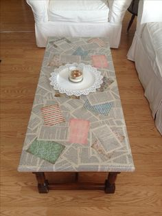 This is my coffee table! I decoupaged pages from my favorite book (Pride and Prejudice) and some pretty scrapbook paper onto the surface. I love the way it turned out.