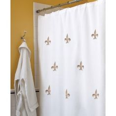 Elevate your bathroom with matching Fleur de Lis embroidered shower curtain and towels.