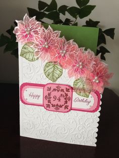 A special birthday card with embossed flowers on vellum.