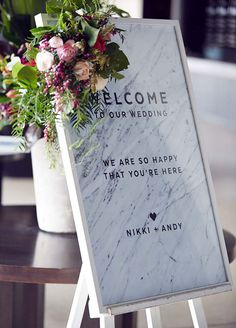 Welcome your guests warmly with a personalized marble wedding sign! Add flowers for extra flair.