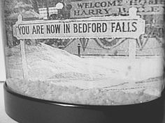 Click Image to Buy:  This snow globe features the very first shot of the Frank Capra holiday classic, It's a Wonderful Life . Now you can be a resident of Bedford Falls year-round ! (Note the Welcome Home Harry Bailey banners in the background.) 24.99