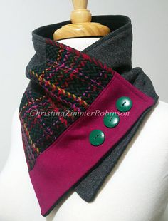 Wearable art statement piece for any outfit. This neck warmer scarf is made with upcycled fuchsia, multi-color plaid, and gray vintage fabric. Adorned with three round green buttons. Backed with black non-pill fleece for added warmth and structure. Secures around neck with snap. This