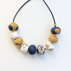 Navy, mustard and white bead necklace, polymer clay necklace, beaded necklace handmade by rubybluejewels by Rubybluejewels on Etsy https://www.etsy.com/au/listing/523706580/navy-mustard-and-white-bead-necklace