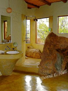 I love how this rock shower is completely open and windows, wow...not loving the yellow though