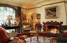 Home Design and Decor , Tudor Style Homes Interior : Tudor Style Homes With Arm Chairs And Round Table With Drawer And Console Table And Fireplace And Wall Hanging Art And Area Rug