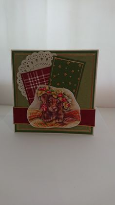 December Sketch Challenge. I have used a die cut paper tole image for this card and layers of pretty papers.