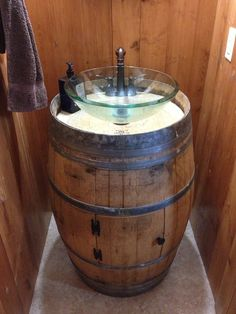 After you start using your barrel, the top section of the barrel will start to dry-out, which could create the barrel to slightly leak. A wine barrel is a good resource for recycled wood. Wine Barrel Sink Bathroom, Vessel Sink Bathroom, Pedestal Sink, Whiskey Barrel Sink, Barris, Outdoor Sinks, Wine Barrel Furniture, Modern Rustic Decor, Soaker Tub