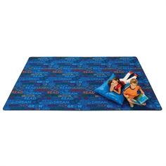 "Read to Dream Pattern Rug - Features the words LEARN, READ, DREAM and GROW, inspiring readers of all ages. Recyclable nylon carpet is treated with stain-resistant materials and has a lifetime anti-microbial protection that minimizes product deterioration and odors. Also backed by a lifetime anti-static and ""no-fault"" serge warranty. Made in the USA. Green Label Plus certification. Available in other sizes, nature colors and a border design"