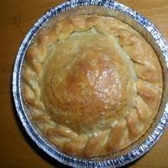 Diced chicken is combined with cream cheese, cream of chicken soup and mixed vegetables. This tasty, very creamy filling is poured into a pastry-lined pan, covered with a top crust, and baked until the pie is tender and golden.