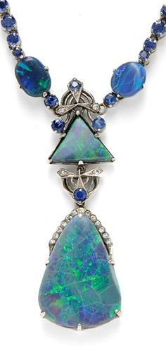 14kt White Gold, Black Opal, and Sapphire Pendant Necklace set with shaped opals and suspended from a necklace of graduating circular-cut sapphires, diamond melee accents.