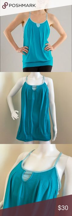 Lululemon Let It Loose Tank Size 10 Surge Blue Gently used no stains or holes. Tons of wear left. Built in bra, has padding inside. Generic pads not Lululemon. Blue with blue white striped shelf bra. Size 10 lululemon athletica Tops Tank Tops