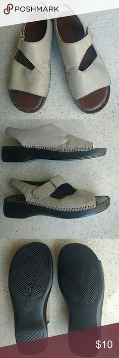 Naturalizer Sandals, Tan Very soft leather with absolutely no damage, scuffs, or stains.  Footbed shows no wear. Non-slip sole has very minimal wear.  Tread still intact.  Elastic at heal. Strap adjusts with Velcro. No toe fungus or athletes foot!  Very comfy :) Naturalizer Shoes Sandals